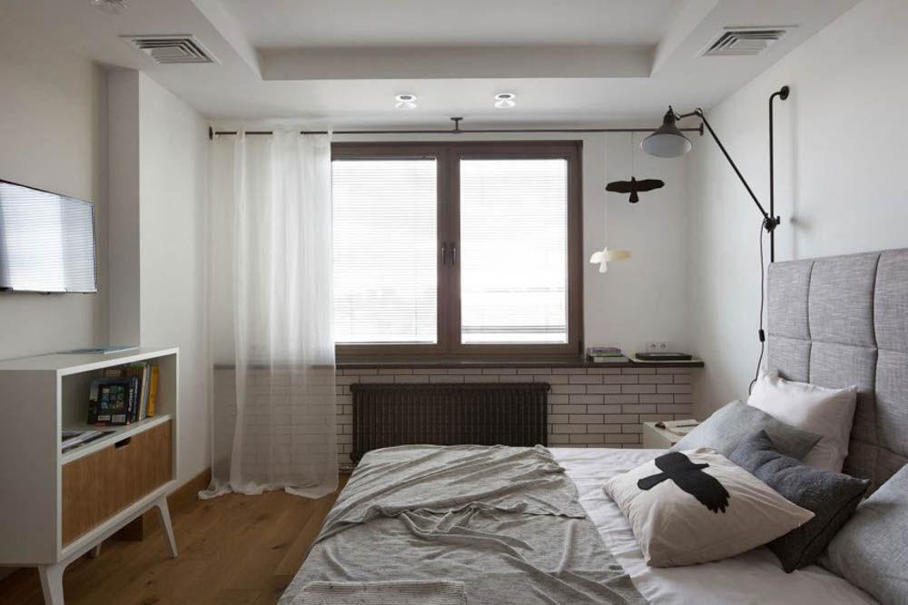 Gam màu trắng kết hợp với cửa sổ kính tạo không gian thoáng đãng